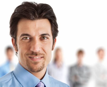men face: Businessman in front of his team Stock Photo
