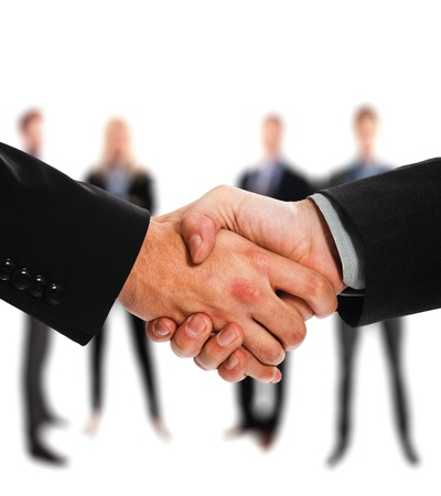 chief executive officers: Close-up of two businessmen shaking hands Stock Photo