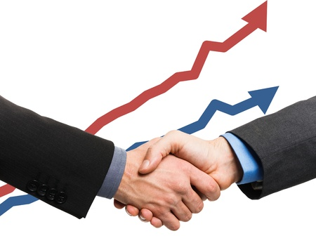 deal in: Businessmen sealing a deal in front of rising arrows Stock Photo