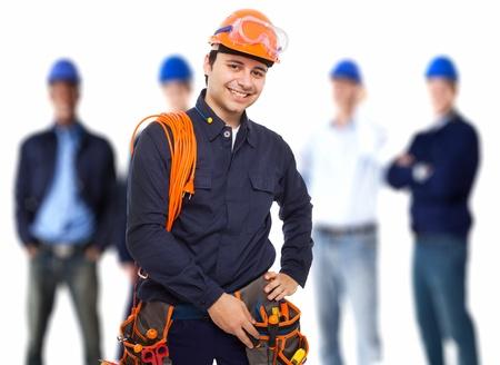 elektriciteit: Portret van een lachende werknemer voor zijn team Stockfoto