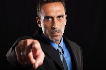 hire: Confident businessman pointing his finger at you