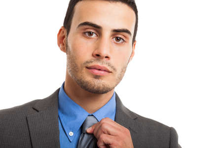 Portrait of a businessman adjusting his necktie Stock Photo - 17340821