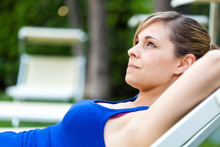 country club: Portrait of a woman relaxing in a country club Stock Photo