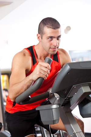 Man doing fitness in a gym photo