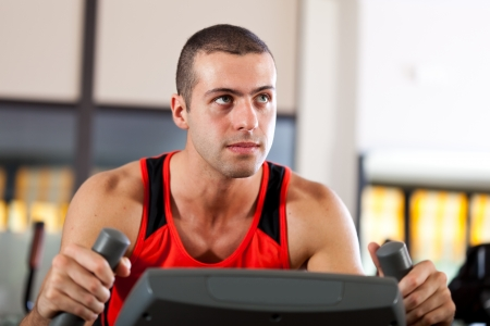 Man doing fitness in a gym Stock Photo - 17340827