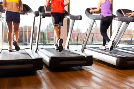 treadmill: Group of people doing fitness in a gym Stock Photo