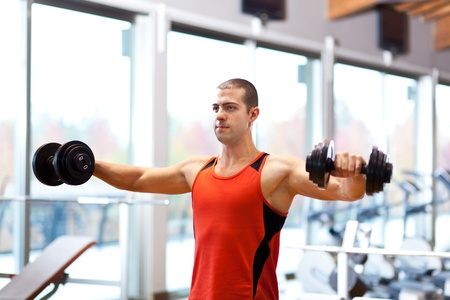 sports hall: Man doing fitness in a gym