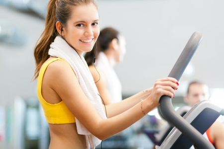 cardio workout: Woman doing fitness in a gym