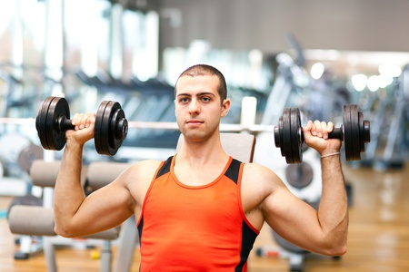 weight lifting: Man doing fitness in a gym