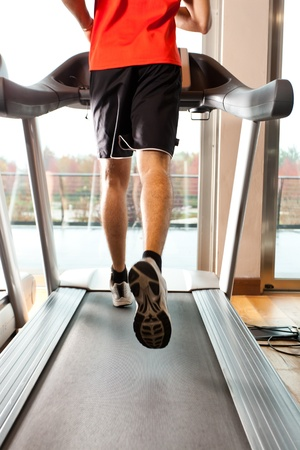 treadmill: Man doing fitness in a gym