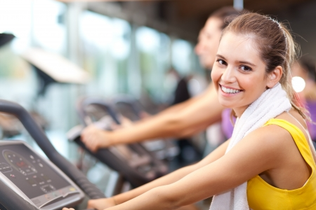 cardio workout: Group of people doing fitness in a gym Stock Photo