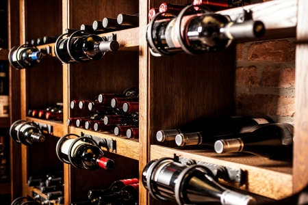wine background: Wine cellar full of wine bottles
