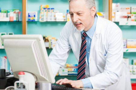 pharmacist: Man at work in a pharmacy Stock Photo