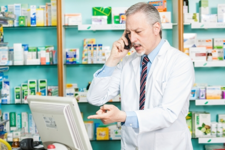 internet shop: Portrait of a pharmacist at work Stock Photo