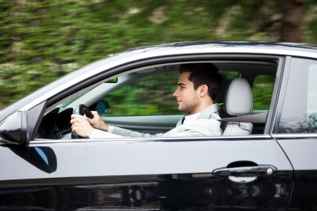 car driving: Portrait of a man driving a car Stock Photo