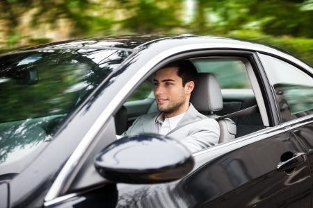 new motor car: Portrait of a man driving a car Stock Photo