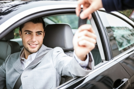 car dealer: Man taking car key