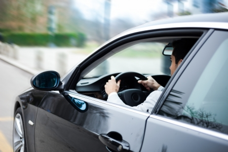 auto leasing: Portrait of a man driving a car Stock Photo