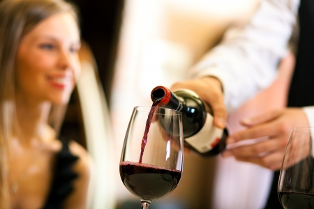 romantic evening with wine: Couple having dinner in a restaurant