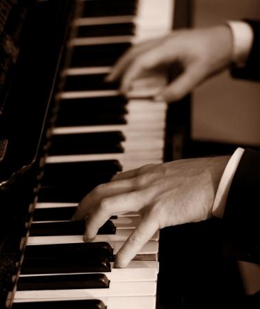 piano keyboard: Man playing piano Stock Photo