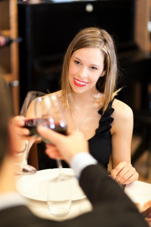 Couple having dinner in a restaurant photo