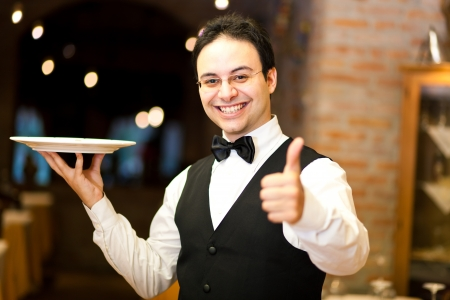 Waiter holding a plate Stock Photo - 17420093