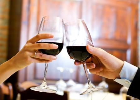 wine red: Couple having dinner in a restaurant