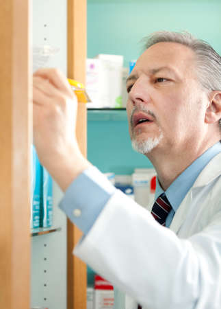 finding the cure: Portrait of a pharmacist at work in his shop