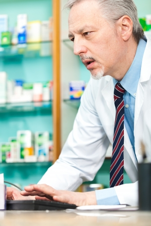 finding a cure: Portrait of a pharmacist at work in his shop