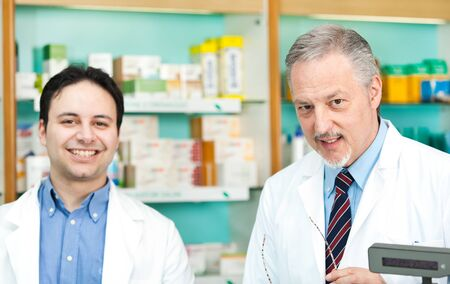 Portrait of pharmacists at work in their shop photo