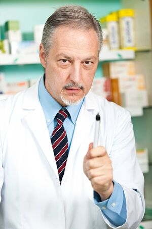 Portrait of a pharmacist at work in his shop Stock Photo - 17575424