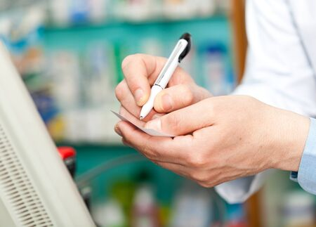 Portrait of a pharmacist at work in his shop Stock Photo - 17575327