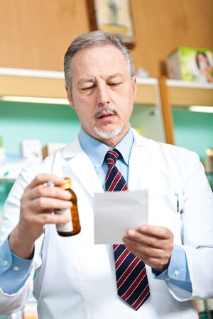 Portrait of a pharmacist at work in his shop Stock Photo - 17575316