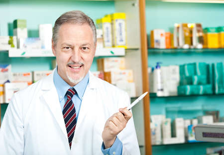 Portrait of a pharmacist at work in his shop Stock Photo - 17547517