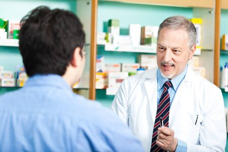 pharmaceutics: Portrait of a pharmacist at work in his shop