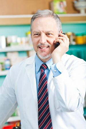 Portrait of a pharmacist at work in his shop photo