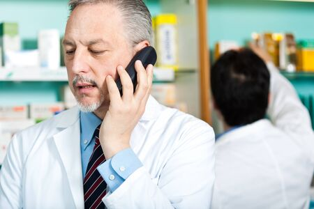 Portrait of a pharmacist at work in his shop Stock Photo - 17575419