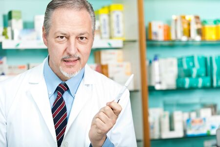 Portrait of a pharmacist at work in his shop Stock Photo - 17575317