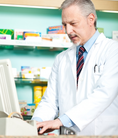 Portrait of a pharmacist at work in his shop Stock Photo - 17575509