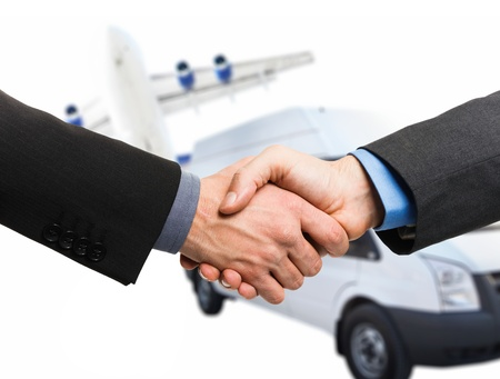 consign: Businessman shaking hands to seal a deal