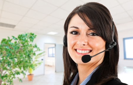 contact center: Portrait of a beautiful customer representative in an office environment Stock Photo