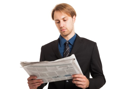 Portrait of a young businessman reading a newspaper photo