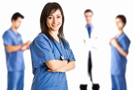 Portrait of a nurse in front of her medical team Stock Photo - 17575201