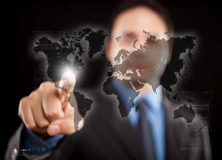 Man pointing his finger on a digital world map Stock Photo - 17575462