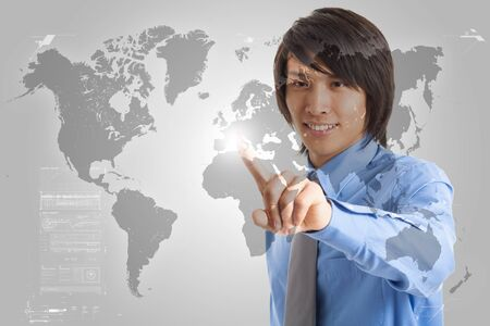 Man pointing his finger on a digital world map photo
