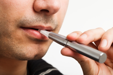 Close-up of a man smoking an electronic cigarette photo