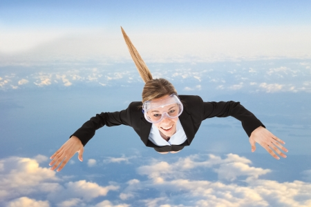 skydiving: Portrait of funny business woman skydiving