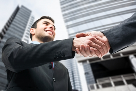 sales meeting: Business people shaking hands