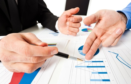 financial analysis: Business people at work during a meeting Stock Photo