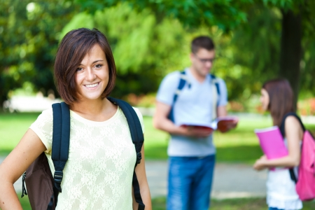 master degree: Outdoor portrait of a smiling student